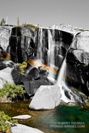 Selective color. Rainbow in waterfalls at Enchanged Pool